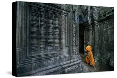 A Monk Explores the Ancient Ruins of the Angkor Wat Temple Complex