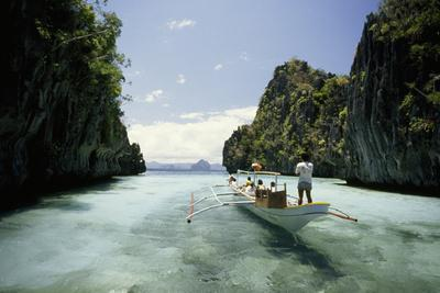 A Tourist Boat Travels Through the Islands of the El Nido Area