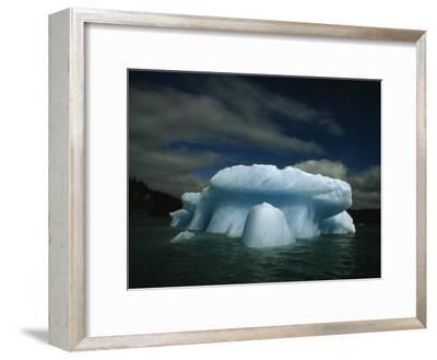 Melting Iceberg under a Cloud Filled Sky
