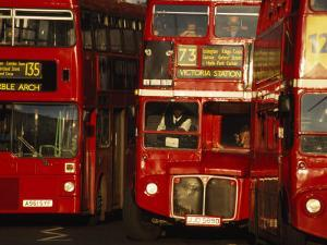 Travelers on Traditional Red Buses in London by Paul Chesley