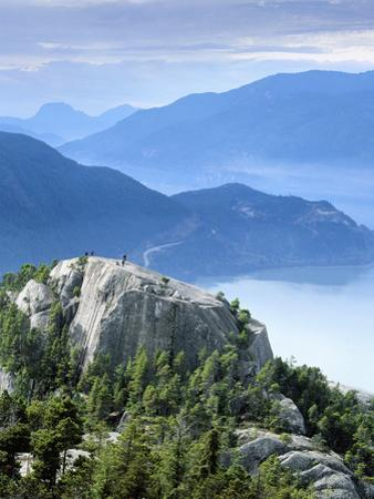 Hikers on Peak of the Chief, Stawamus Chief Provincial Park, Squamish, British Columbia, Canada by Paul Colangelo