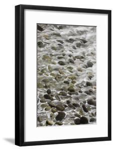 Surf Runs Through Stones on a Beach by Paul Colangelo