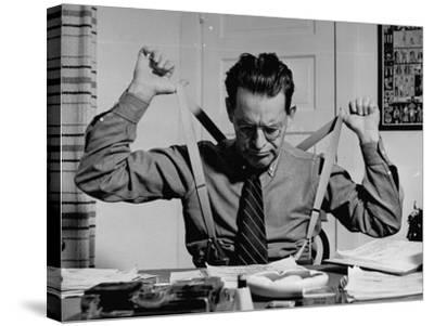 Screenwriter Jack Cunningham Snapping Suspenders as He Works on Harold Lloyd's New Film