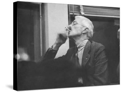 Writer Dashiell Hammett Smoking a Cigarette