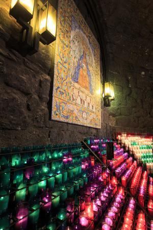 Lit Candles Within a Small Grotto, Benedictine Monastery, Barcelona, Spain