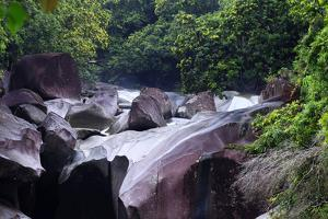 The Babinda Boulders Is a Fast-Flowing River Surrounded by Smooth Boulders, Queensland, Australia by Paul Dymond