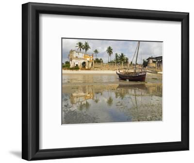 East Africa, Tanzania, Zanzibar, A Boat Moored on the Sands of Bagamoyo