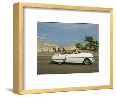 Havana, Classic Vintage American Car Driving on the Malecon, Havana, Cuba