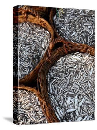Baskets of Fish on Beach