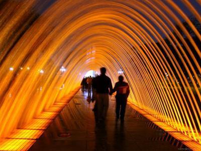 People Walking Through One of the 13 Illuminated Fountains at El Parque De La Reserva