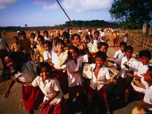 Playtime for School Children of Watu Karere, Sumba, East Nusa Tenggara, Indonesia by Paul Kennedy