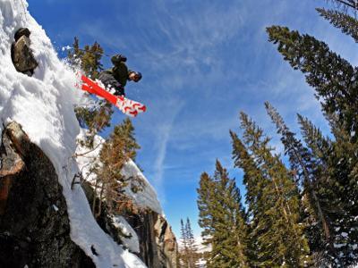 Skier Jumping Off Small Cliff at Brighton Ski Resort