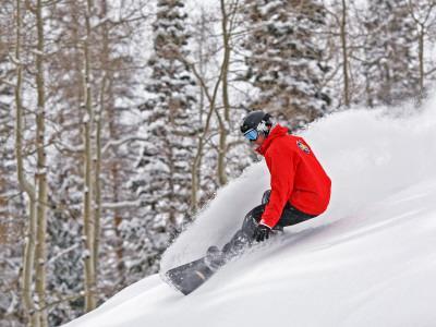 Snowboarder Enjoying Deep Fresh Powder at Brighton Ski Resort