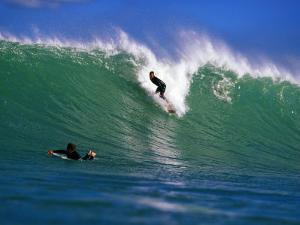 Surfer at Waikanae Beach, Poverty Bay, Gisborne, New Zealand by Paul Kennedy