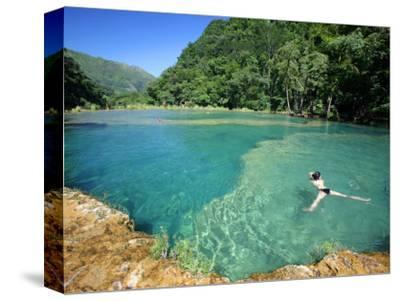 Visitors Swimming in Turquoise-Coloured Waters of Semuc Champey