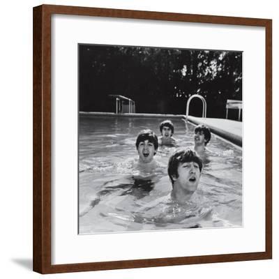 Paul McCartney, George Harrison, John Lennon and Ringo Starr Taking a Dip in a Swimming Pool--Framed Premium Photographic Print