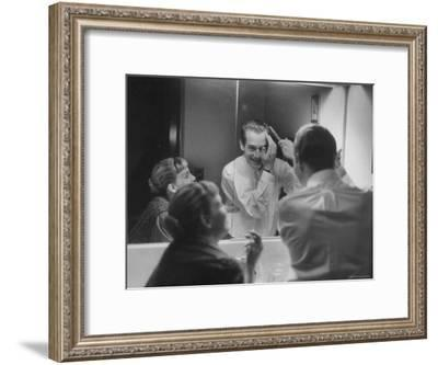Paul Newman Talking to His Wife Joanne Woodward While Getting Dressed-Gordon Parks-Framed Premium Photographic Print