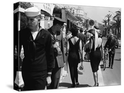 American Serviceman Admiring Two Female Pedestrians at the Cannes Film Festival