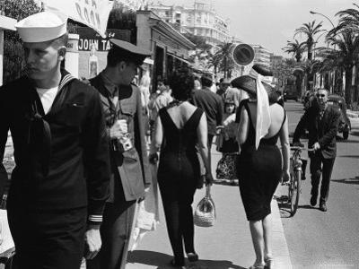 American Serviceman Admiring Two Female Pedestrians at the Cannes Film Festival by Paul Schutzer