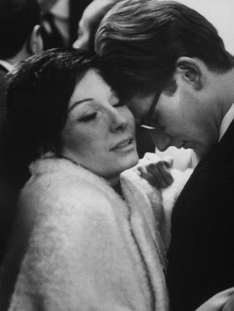 Dancer Renee Jeanmaire Embracing Yves Saint Laurent at Fashion Show
