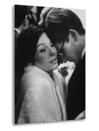 Dancer Renee Jeanmaire Embracing Yves Saint Laurent at Fashion Show by Paul Schutzer