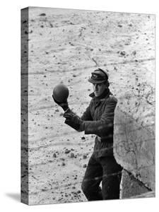 East German Border Guard Tossing Ball over Berlin Wall after German boy accidently threw it over by Paul Schutzer