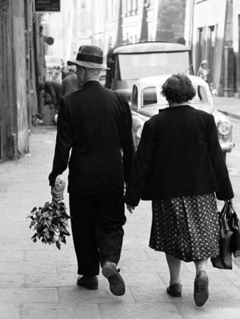 Elderly Polish Couple Walking Hand in Hand by Paul Schutzer