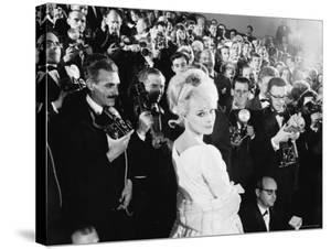 Elke Sommer Attending the Cannes Film Festival Amid a Sea of Photographers by Paul Schutzer