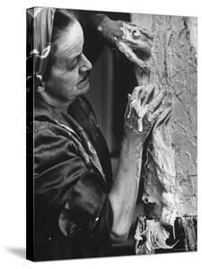 English Sculptor, Barbara Hepworth, at Work in Her Studio by Paul Schutzer