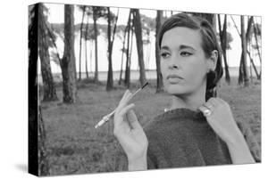 Gloria Vanderbilt Smoking Outside and Showing New Hairdo, 1963 by Paul Schutzer