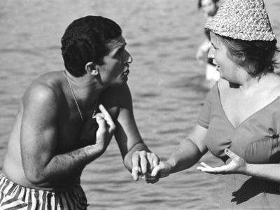Italian Man Talking to a Woman While Enjoying a Day at the Beach by Paul Schutzer