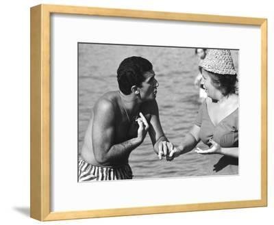 Italian Man Talking to a Woman While Enjoying a Day at the Beach