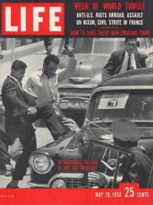 Men Kicking Car of Vice Pres Richard Nixon, South American Goodwill Trip, Venezuela, May 26, 1958 by Paul Schutzer