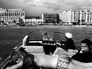 People Sunbathing During the Cannes Film Festival by Paul Schutzer