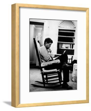 President John F. Kennedy Sitting Alone, Thoughtfully, in His Rocking Chair in the Oval Office