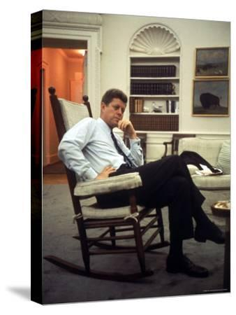 President John F. Kennedy Sitting in Rocking Chair in His White House Office