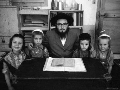 Rabbi Posing with His Young Students Who Are Learning to Read Hebrew at This Orthodox School by Paul Schutzer