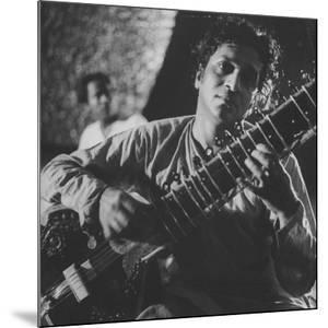 Ravi Shankar Passionately Playing the Sitar by Paul Schutzer