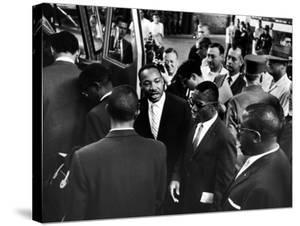 Reverend Martin Luther King Jr. with Freedom Riders Boarding Bus for Jackson by Paul Schutzer