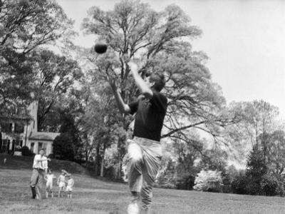 Robert F Kennedy and Family Outside Playing Football with His Brother Senator John F. Kennedy by Paul Schutzer