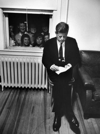 Senator John F. Kennedy Checking over Speech During His Presidential Campaign