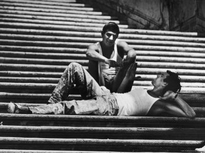 Two Young Italian Workmen Loafing on the Spanish Steps During Lunch Hour by Paul Schutzer