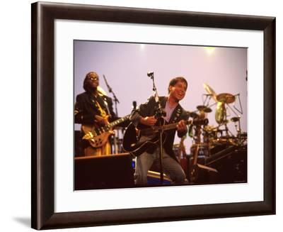 Paul Simon Performing with Band Musicians--Framed Premium Photographic Print