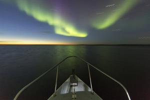 Canada, Nunavut, Aurora Borealis Glows in Night Sky Above Hudson Bay by Paul Souders