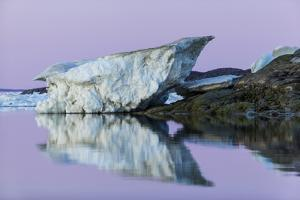Canada, Nunavut, Iceberg Reflected in Calm Waters at Dusk by Paul Souders