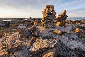 Canada, Nunavut Territory, Sunset Lights Cairns on Harbor Islands by Paul Souders