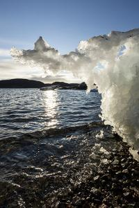 Canada, Nunavut Territory, Sunset Lights Melting Iceberg in Hudson Bay by Paul Souders