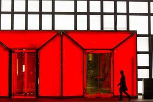 China, Beijing, Silhouette of Shopper Walking Past Shopping Mall by Paul Souders