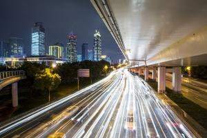 China, Shanghai, Blurred Image of Car and Bus Traffic of Yan'An Road by Paul Souders