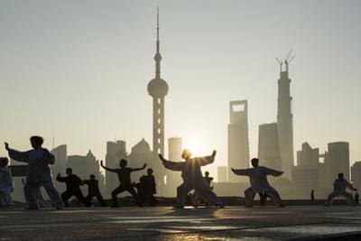 China, Shanghai, Martial Arts Group Practicing Tai Chi at Dawn